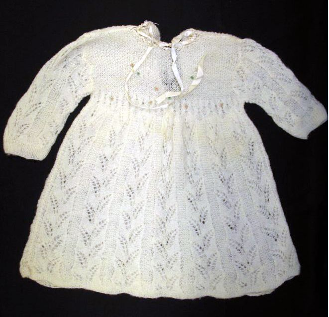 Knitted child's dress from QM Collection