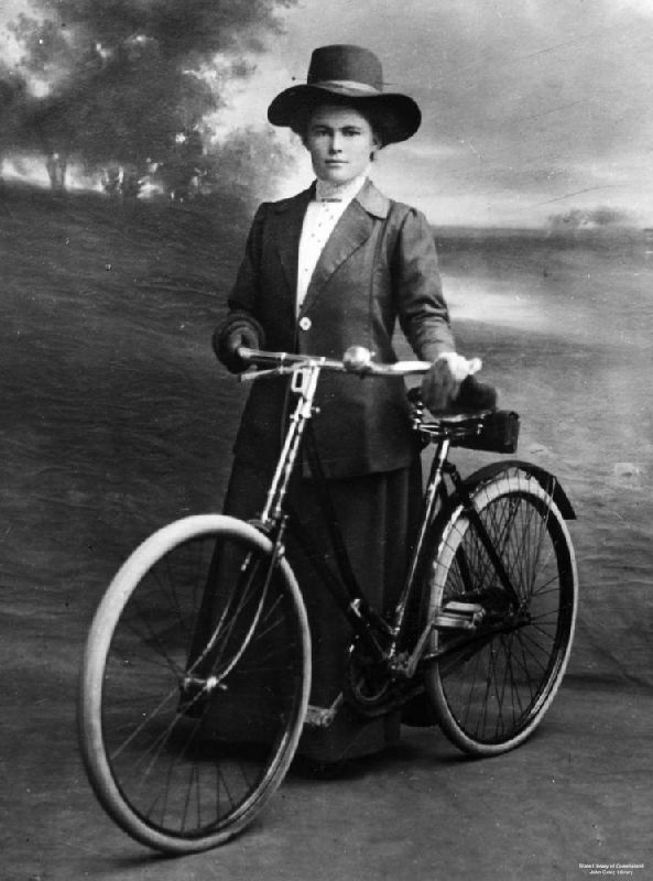 A female cyclist kitted out in the 'rational dress' style of the late 19th century