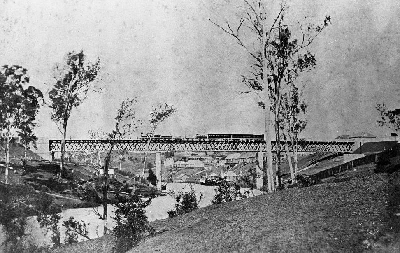 Early train crossing the Bremer River Bridge in 1867